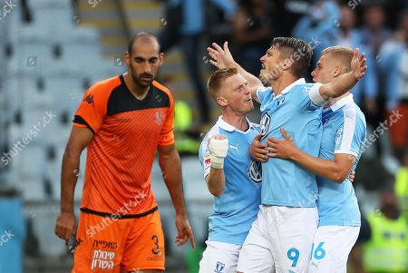 Stock Picture of Malmo's Markus Rosenberg (2-R) celebrates with his teammates Anders Christiansen (C) and Felix Beijmo (R) after scoriong the 1-0 lead during the UEFA Europa League playoff, first leg soccer match between Malmo FF and Bnei Yehuda Tel Aviv FC in Malmo, Sweden, 22 August 2019.
