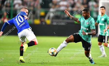 Cafu (R) of Legia in action against Steven Davis (L) of Rangers during the UEFA Europa League playoff, first leg soccer match between Legia Warsaw and Glasgow Rangers in Warsaw, Poland, 22 August 2019.