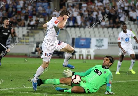 Molde?s Kristoffer Haraldseid in action against Partizan?s goalkeeper Vladimir Stojkovic (bottom) during the UEFA Europa League playoff, first leg soccer match between FK Partizan and Molde FK in Belgrade, Serbia, 22 August 2019.