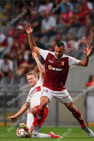 Stock Photo of Braga's Fransergio (R) in action against Spartak Moscow's Andre Schuerrle (L) during the UEFA Europa League playoff, first leg soccer match between Sporting Braga and Spartak Moscow in Braga, Portugal, 22 August 2019.