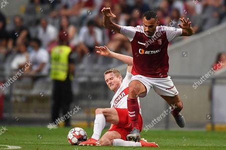 Braga's Fransergio (R) in action against Spartak Moscow's Andre Schuerrle (L) during the UEFA Europa League playoff, first leg soccer match between Sporting Braga and Spartak Moscow in Braga, Portugal, 22 August 2019.