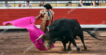 Spanish bullfighter Julian Lopez 'El Juli' fights a bull during Bilbao's Fair in Bilbao, Basque Country, Spain, 22 August 2019.
