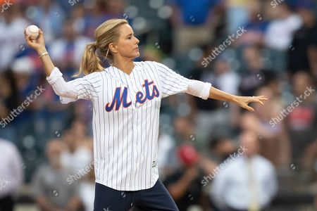 "Stock Photo of Actress Tea Leoni throws a ceremonial first pitch during the filming of ""Madame Secretary"" before the start of a baseball game between the New York Mets and the Cleveland Indians, in New York"