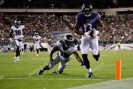 Baltimore Ravens' Michael Floyd (13) scores a touchdown past Philadelphia Eagles' Jeremiah McKinnon (38) during the first half of a preseason NFL football game, in Philadelphia