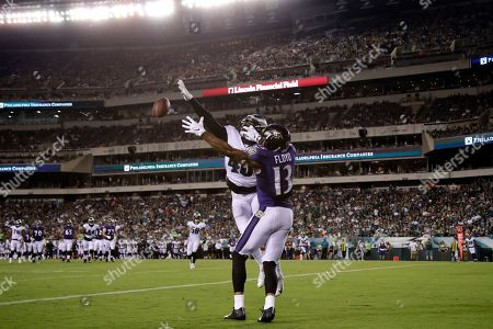 Philadelphia Eagles' Josh Hawkins, left, breaks up a pass in the end zone intended for Baltimore Ravens' Michael Floyd during the first half of a preseason NFL football game, in Philadelphia