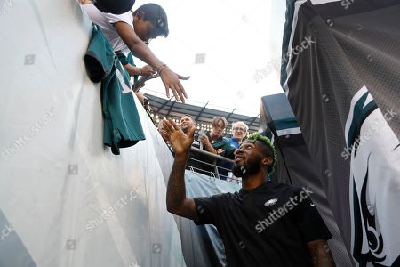 Philadelphia Eagles' Jalen Mills greets fans before a preseason NFL football game against the Baltimore Ravens, in Philadelphia