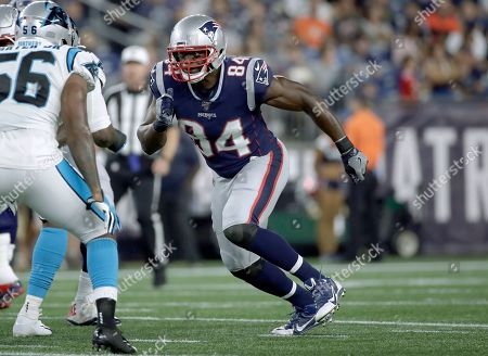 New England Patriots tight end Benjamin Watson, right, runs a pass route against the Carolina Panthers in the first half of an NFL preseason football game, in Foxborough, Mass
