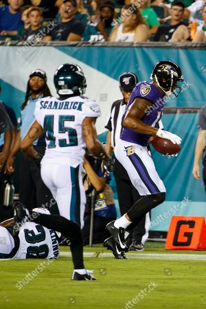 Baltimore Ravens wide receiver Michael Floyd (13) with the touchdown over Philadelphia Eagles defensive back Jeremiah McKinnon (38) during the NFL preseason game between the Baltimore Ravens and the Philadelphia Eagles at Lincoln Financial Field in Philadelphia, Pennsylvania