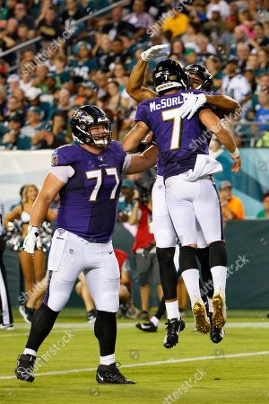 Baltimore Ravens quarterback Trace McSorley (7) celebrates his touchdown throw with wide receiver Michael Floyd (13) along with center Bradley Bozeman (77) during the NFL preseason game between the Baltimore Ravens and the Philadelphia Eagles at Lincoln Financial Field in Philadelphia, Pennsylvania