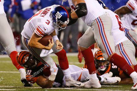 Alex Tanney, Kerry Wynn. New York Giants quarterback Alex Tanney (3) is sacked by Cincinnati Bengals defensive end Kerry Wynn (72) during the second half of an NFL preseason football game, in Cincinnati
