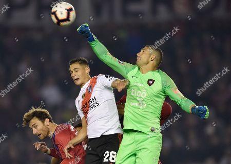 Goalkeeper Juan Pablo Carrizo of Paraguay's Cerro Porteno blocks the ball next to Lucas Quarta of Argentina's River Plate during a Copa Libertadores soccer match in Buenos Aires, Argentina