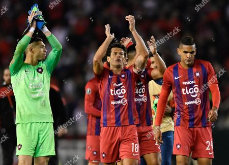 From left, Juan Pablo Carrizo, Nelson Haedo and Juan Saiz of Paraguay's Cerro Porteno acknowledge their fans after losing a Copa Libertadores soccer match to Argentina's River Plate in Buenos Aires, Argentina
