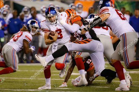 New York Giants quarterback Daniel Jones (8) is sacked by Cincinnati Bengals defensive end Kerry Wynn (72) during the second half of an NFL preseason football game, in Cincinnati