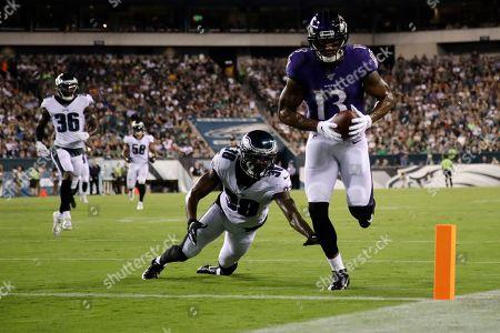 Jeremiah McKinnon, Michael Floyd. Baltimore Ravens' Michael Floyd (13) scores a touchdown past Philadelphia Eagles' Jeremiah McKinnon (38) during the first half of a preseason NFL football game, in Philadelphia