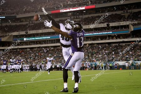 Stock Image of Josh Hawkins, Michael Floyd. Philadelphia Eagles' Josh Hawkins, left, breaks up a pass intended for Baltimore Ravens' Michael Floyd in the end zone during the first half of a preseason NFL football game, in Philadelphia