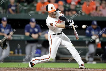 Baltimore Orioles' Stevie Wilkerson flies out to left field against Tampa Bay Rays starting pitcher Ryan Yarbrough during the fifth inning of a baseball game, in Baltimore