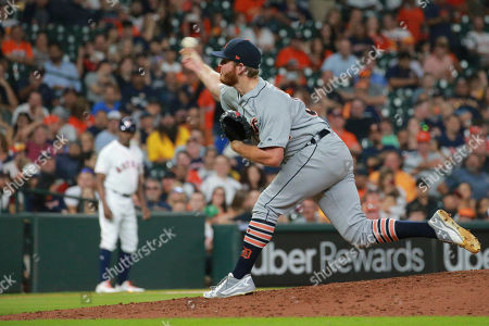 Detroit Tigers reliever David McKay delivers a pitch against the Houston Astros in the seventh inning of a baseball game, in Houston