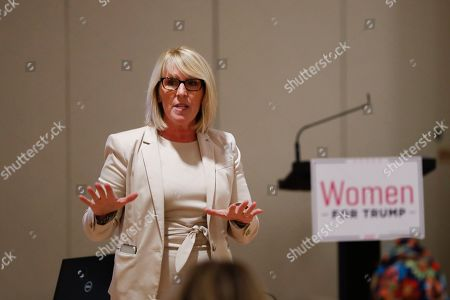 Laura Cox, Chairman of the Michigan Republican Party, speaks during a training session for Women for Trump, An Evening to Empower, in Troy, Mich., . President Donald Trump's campaign is rallying and training a corps of female defenders, mindful that Trump's shaky standing with women could sink his hopes of reelection next year. Female surrogates and supporters fanned out across important battlegrounds Thursday in a high-profile push to make the president's case on the economy and to train campaign volunteers