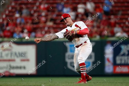 St. Louis Cardinals second baseman Kolten Wong throws out Colorado Rockies' Daniel Murphy at first during the eighth inning of a baseball game, in St. Louis