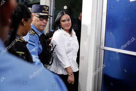 Former Honduran first lady Rosa Elena Bonilla de Lobo leaves court after her conviction on corruption charges in Tegucigalpa, Honduras. The court convicted the former first lady on Tuesday of embezzling about $600,000 in government money between 2010 and 2014, when her husband Porfirio Lobo was president. Bonilla's sentence will be announced Aug. 28 and could run between 58 and 87 years in prison