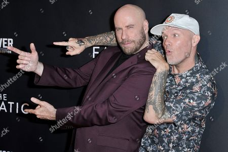 "John Travolta, Fred Durst. John Travolta, left, and Fred Durst attend the LA premiere of ""The Fanatic"" at the Egyptian Theatre, in Los Angeles"