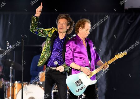 Mick Jagger, Keith Richards. Mick Jagger, left, and Keith Richards of the Rolling Stones perform during their concert at the Rose Bowl, in Pasadena, Calif