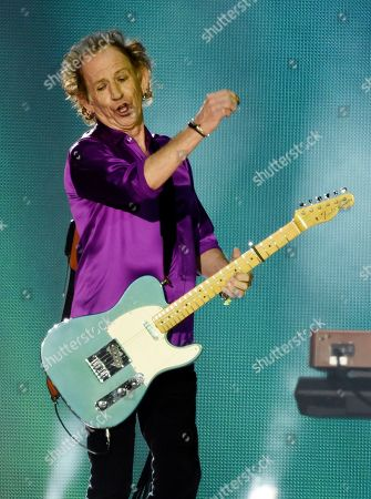 Keith Richards of the Rolling Stones performs during the group's concert at the Rose Bowl, in Pasadena, Calif