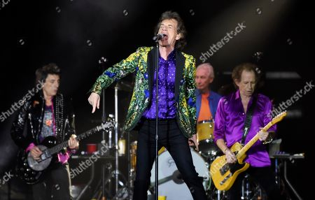 Mick Jagger, Keith Richards, Ron Wood, Charlie Watts. Mick Jagger, center, performs with his Rolling Stones bandmates, from left, Ron Wood, Charlie Watts and Keith Richards at the Rose Bowl, in Pasadena, Calif