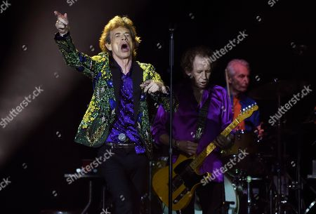 Mick Jagger, Keith Richards, Charlie Watts. Mick Jagger, Keith Richards and Charlie Watts, from left, of the Rolling Stones perform during the band's concert at the Rose Bowl, in Pasadena, Calif