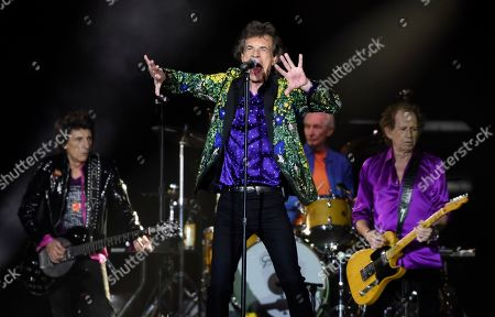 Mick Jagger, Ron Wood, Charlie Watts, Keith Richards. Mick Jagger, center, performs with his Rolling Stones bandmates, from left, Ron Wood, Charlie Watts and Keith Richards during their concert at the Rose Bowl, in Pasadena, Calif