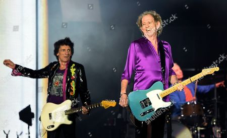 Ron Wood, Keith Richards. Ron Wood, left, and Keith Richards of the Rolling Stones perform during their concert at the Rose Bowl, in Pasadena, Calif