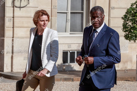 French director and women rights activist Caroline Fourest (L) and Congolese gynecologist, 2018 Nobel Prize Denis Mukwege (R) and members of the G7 Advisory Board for Gender Equality arrive at the Elysee Palace for a meeting with French President Macron in Paris, France, 23 August 2019.