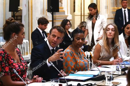French President Emmanuel Macron (2-L) leads a meeting of the G7 Advisory Council for Equality between Women and Men as part of the 'Day of Dialogue', with United Nations Under-Secretary-General and Executive Director of UN Women Phumzile Mlambo-Ngcuka (3-R), leader of the feminist activist group Femen Inna Shevchenko (2-R) and French Junior Minister for Gender Equality Marlene Schiappa (L), at the Elysee presidential palace in Paris, France, 23 August 2019. The G7 Summit runs from 24 to 26 August in Biarritz.