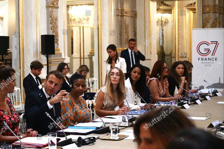 French President Emmanuel Macron (2-L) leads a meeting of the G7 Advisory Council for Equality between Women and Men as part of the 'Day of Dialogue', with United Nations Under-Secretary-General and Executive Director of UN Women Phumzile Mlambo-Ngcuka (3-L), leader of the feminist activist group Femen Inna Shevchenko (4-L) and French Junior Minister for Gender Equality Marlene Schiappa (L), at the Elysee presidential palace in Paris, France, 23 August 2019. The G7 Summit runs from 24 to 26 August in Biarritz.