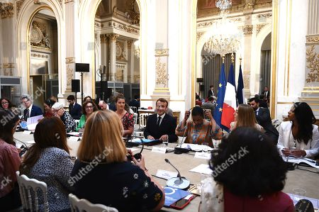 French President Emmanuel Macron (C) leads a meeting of the G7 Advisory Council for Equality between Women and Men as part of the 'Day of Dialogue', with United Nations Under-Secretary-General and Executive Director of UN Women Phumzile Mlambo-Ngcuka (3-R), leader of the feminist activist group Femen Inna Shevchenko (2-R) and French Junior Minister for Gender Equality Marlene Schiappa (6-L), at the Elysee presidential palace in Paris, France, 23 August 2019. The G7 Summit runs from 24 to 26 August in Biarritz.