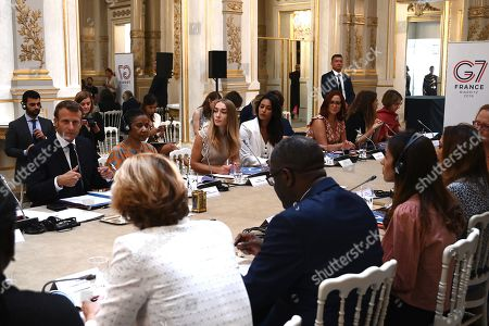 French President Emmanuel Macron (L) leads a meeting of the G7 Advisory Council for Equality between Women and Men as part of the 'Day of Dialogue', with United Nations Under-Secretary-General and Executive Director of UN Women Phumzile Mlambo-Ngcuka (2-L), leader of the feminist activist group Femen Inna Shevchenko (3-L) and 2018 Nobel Peace Prize Nadia Murad (3rdR) and Denis Mukwege (4-R), at the Elysee presidential palace in Paris, France, 23 August 2019. The G7 Summit runs from 24 to 26 August in Biarritz.