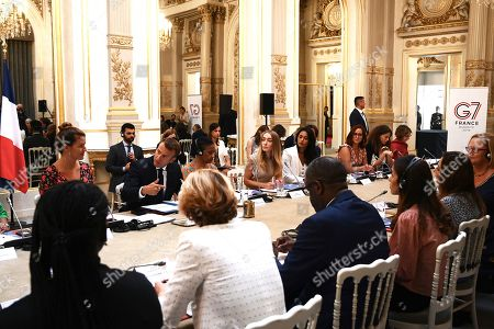 French President Emmanuel Macron (2-L) leads a meeting of the G7 Advisory Council for Equality between Women and Men as part of the 'Day of Dialogue', with French Junior Minister for Gender Equality Marlene Schiappa (L), United Nations Under-Secretary-General and Executive Director of UN Women Phumzile Mlambo-Ngcuka (3-L), leader of the feminist activist group Femen Inna Shevchenko (4-L) and 2018 Nobel Peace Prize Nadia Murad (3-R) and Denis Mukwege (4-R), at the Elysee presidential palace in Paris, France, 23 August 2019. The G7 Summit runs from 24 to 26 August in Biarritz.