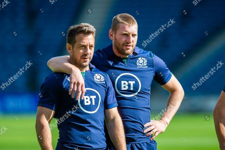 Stock Picture of Scotland team mates Greg Laidlaw (left) and Finn Russell watch a passing drill during the Scotland Rugby training run ahead of their match against France at BT Murrayfield Stadium, Edinburgh
