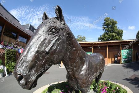 Stock Photo of The Frankel statue near to the Sir Henry Cecil Gate Entrance on Day 4 of  the Ebor Festival at York Racecourse, York