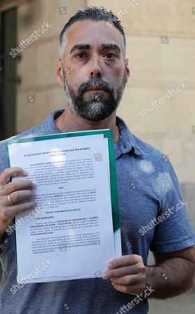 The vice president of the Facua-Consumidores en Accion association Ruben Sanchez shows a letter of complaint against the company Magrudis SL, producer and manufacturer of pork meat contaminated with Listeria bacteria, in Seville, Andalusia, Spain, 23 August 2019. Sanchez filed a complaint against a possible crime against public health.