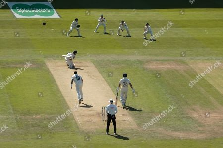England's Ben Stokes is caught by Australia's David Warner, upper centre right, off the bowling of James Pattinson on the second day of the 3rd Ashes Test cricket match between England and Australia at Headingley cricket ground in Leeds, England