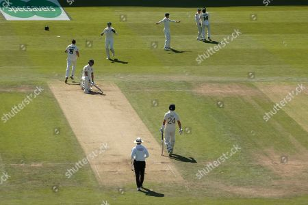 England's Ben Stokes is caught by Australia's David Warner, upper second right, off the bowling of James Pattinson on the second day of the 3rd Ashes Test cricket match between England and Australia at Headingley cricket ground in Leeds, England