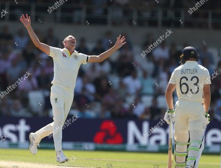 Australia's Josh Hazlewood celebrates after taking the wicket of England's Jos Buttler caught by Australia's Usman Khawaja during play on the second day of the 3rd Ashes Test cricket match between England and Australia at Headingley cricket ground in Leeds, England