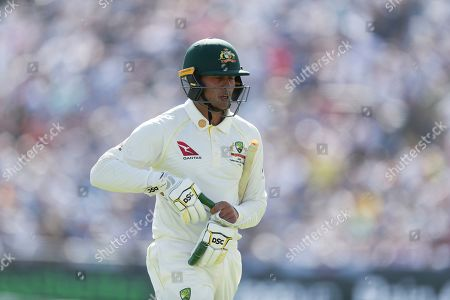 Australia's Usman Khawaja walks from the pitch after being given out caught by England's Jason Roy off the bowling of England's Chris Woakes during play on the second day of the 3rd Ashes Test cricket match between England and Australia at Headingley cricket ground in Leeds, England