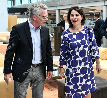 Former German Interior Minister Thomas de Maiziere (L) and Germany's Greens party co-leader Annalena Baerbock during their visit of the Volkswagen Transparent Factory prior to a panel discussion in Dresden, Germany, 23 August 2019.