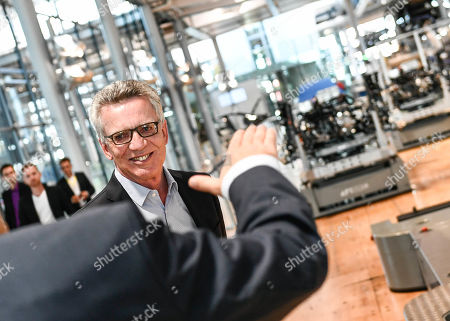 Former German Interior Minister Thomas de Maiziere (CDU) smiles as he visits the Volkswagen Transparent Factory prior to a panel discussion in Dresden, Germany, 23 August 2019.