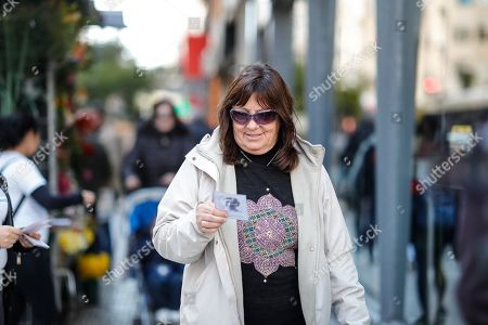 Stock Picture of A woman receives a poem, in Buenos Aires, Argentina, 23 August 2019. Around 100 thousand poems will be delivered in several areas of Argentina to celebrate the 120th anniversary of the birth of Argentinian short story writer Jorge Luis Borges.