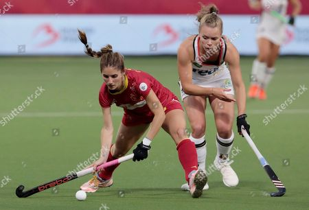 Spain's Lucia Jimenez, left, vies for the ball against Germany's Lena Micheel during a women's European Championship field hockey semi-final match between Spain and Germany at the Wilrijkse Plein, Antwerp, Belgium
