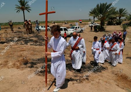 Stock Photo of Iraqi Christians attend Mass at the archaeological site of Kokheh Church south of Baghdad, Iraq, . The historical church located on the left bank of the Tigris River some 20 miles south of the capital Baghdad dates back to the first century AD. Remnants of the church, an archaeological site and one of the most important sites of Eastern Christianity, was reopened again to the public last year after a years-long closure due to security concerns