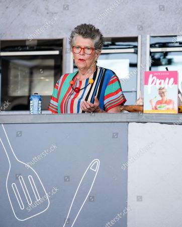 Prue Leith on stage, with broken Achilles tendon